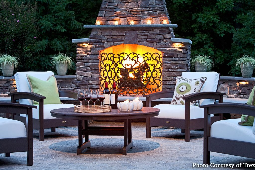 Outdoor living space with fireplace and furnishings