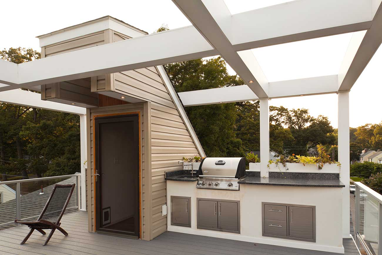 Grill and kitchen area on rooftop deck