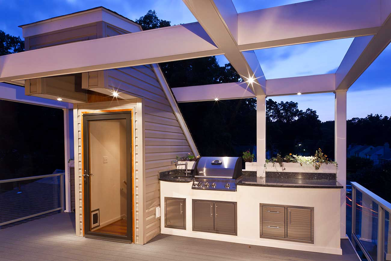 Night view of outdoor kitchen on rooftop deck