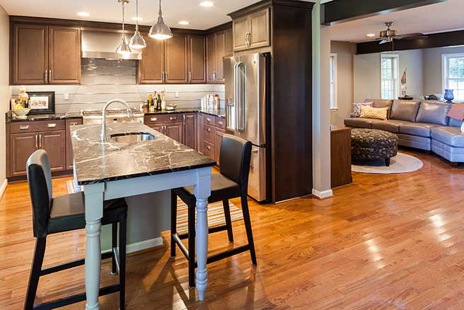 Monkton Kitchen Remodeled with dark wood cabinets and a furniture style island